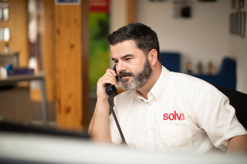Solv Support Worker on Phone