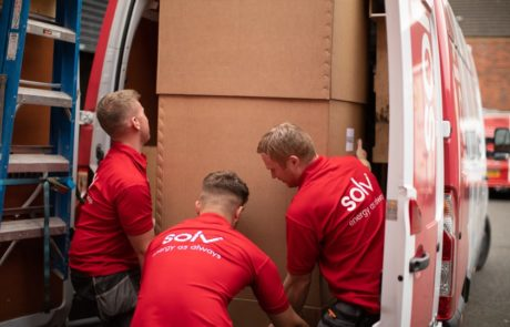 Solv workers moving package