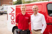 Stephen and Engineer beside Solv van